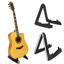цена на Flanger Foldable Smart Guitar Stand Alloy / ABS Holder for ukulele Bass Acoustic Electric Guitar Stand Holder Floor Universal