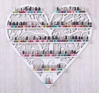 Nail polish store shelves display shelf. Hanging frame, wrought iron heart cosmetics.