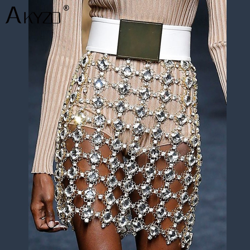 Detail Feedback Questions about AKYZO Sexy Metal Diamonds hollow mini Skirt  Women Luxury Gold rhinestone Chain Sequins Party Outfits Clubwear Skirts on  ... 86e22cc50de5