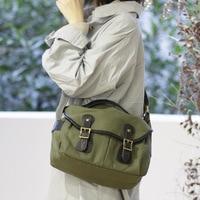 Fashion Canvas Bag Casual Belt Decoration Messenger Bag British Style Wild Shoulder Messenger Package Large capacity Travel Bag