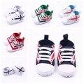 Clásico Newborn Infant Toddler zapatos de bebé zapatillas deportivas inferior suave antideslizante atado-t primeros caminante de Prewalker