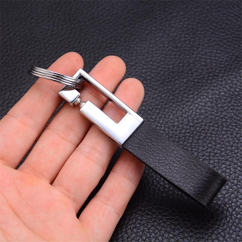 f222b124f5e5 Bycobecy 2019 a la moda nuevo llavero de doble anillo de cuero creativo  llavero de cuero con Logo de coche llavero de cuero de cintura para hombre  ...