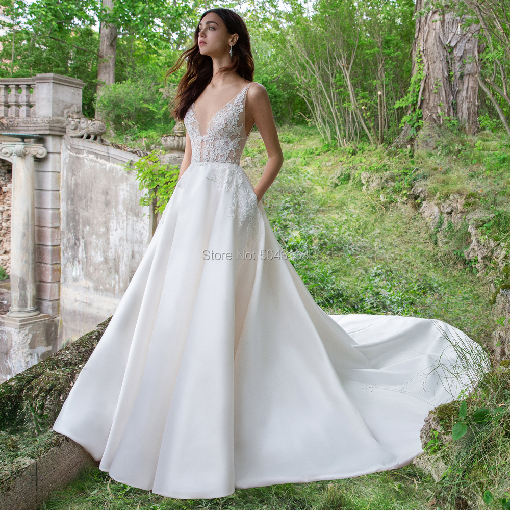 A Line Lace Appliques Satin Wedding Dresses With Pockets Deep V Neck Backless Court Train Wedding Bridal Gowns 2020 Sleeveless