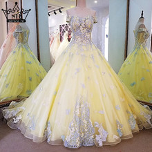 Newest Yellow Sexy Sleeveless Tulle Wedding Dresses Embroidery Sequined Bridal Wedding Dress 2017 Vestido De Noiva(China (Mainland))