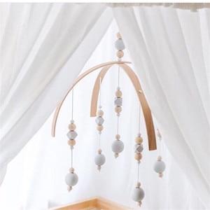 Image 4 - Bébé hochet jouets mobiles perles en bois berceau jouet lit suspendu nouveau né vent carillons cloche nordique enfants chambre décoration photographie accessoires