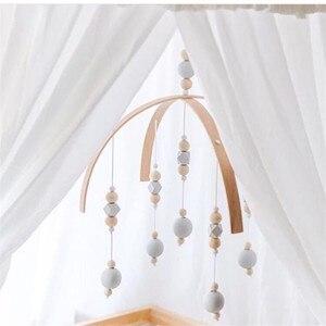Image 4 - Chocalho do bebê brinquedos móveis contas de madeira berço cama brinquedo pendurado recém nascido sinos vento sino nordic crianças decoração do quarto fotografia adereços