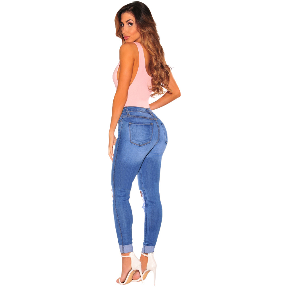 New European and American fashion personality hole wearing high waist stretch solid color slim sexy ladies jeans