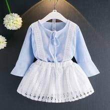 Nieuwe stijl meisje kleding set zomer lange mouwen kant decoratie t-shirt + witte rok 2 stuks kleding pak hete kind kleding Q1