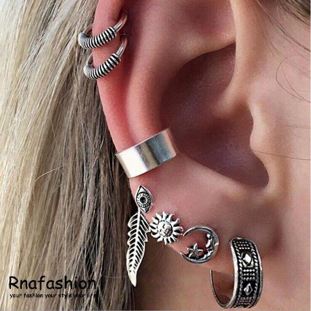 9a5460aeb885 Europeo y americano Retro bohemio sol Luna oreja aretes 8 Unidades de moda  para mujer