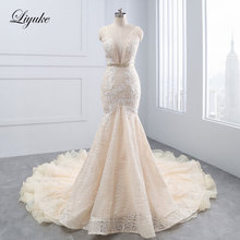Liyuke Tiered Ruffles Organza Deep V-neck Mermaid Wedding Dress Unique Appliques Lace Sleeveless Backless Trumpet Bridal Dresses