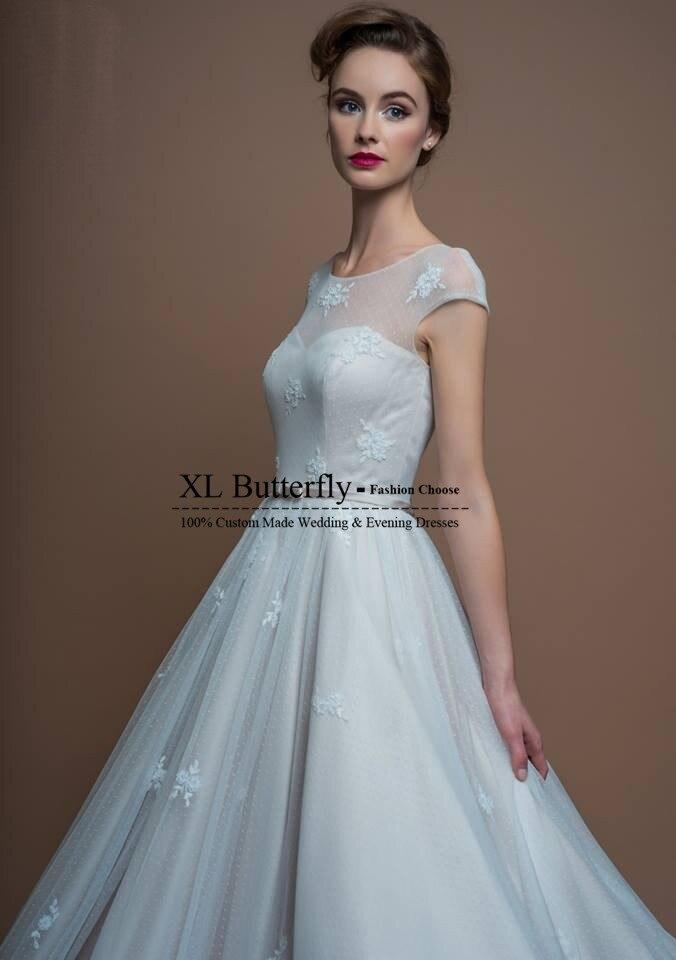 Designer Sheer Scoop Short Sleeves Applique Puffy Skirt Tea Length ...