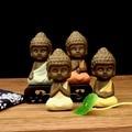 Pequeño buda tathagata estatua estatuilla monje india yoga mandala té mascota púrpura de cerámica artesanías adornos de cerámica decorativa