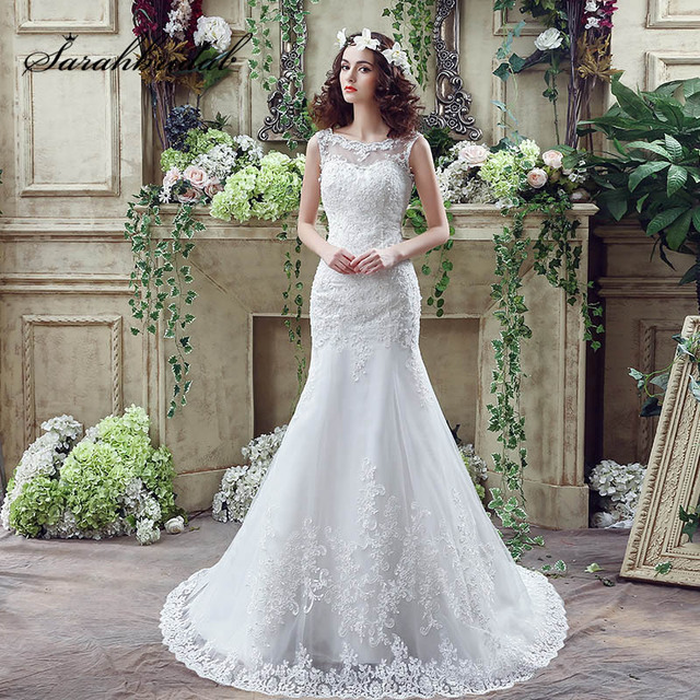 2d314d42b4547 White Romantic Mermaid Lace Applique Wedding Dresses with Sequined Tulle  Sheer Neck Zipper V Back Buttons Bridal Gowns SQ045
