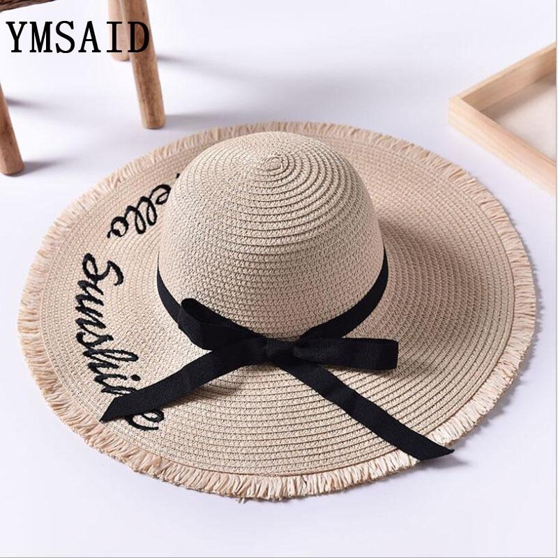 d285297dd7f77 Ymsaid Wide Brim Sun sombreros para mujeres carta bordado arco negro Panamá  paja plegable Floppy playa señoras Chapeu feminino