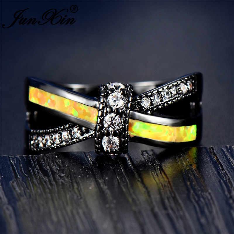 JUNXIN ขายส่ง Rainbow Fire โอปอลแหวนผู้หญิงผู้ชายสีดำทองสีเขียวสีฟ้าโอปอลสีขาวสีแดงสีม่วง Zircon ข้ามแหวน