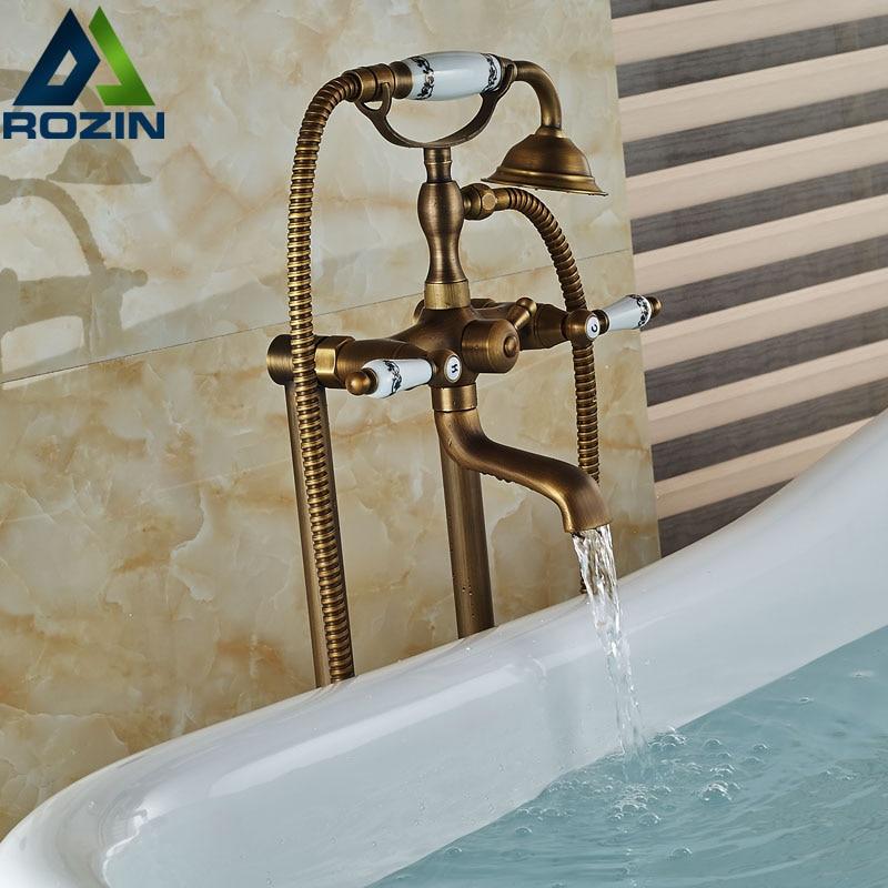 Dual Handles Bathroom Floor Mount Bathtub Filler Freestanding Bathtub Faucet Antique Brass with Hand Shower Rotate Spout