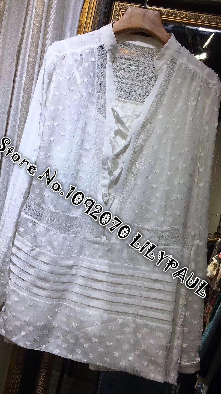 Chemise à lacets en soie blanche à manches longues à pois