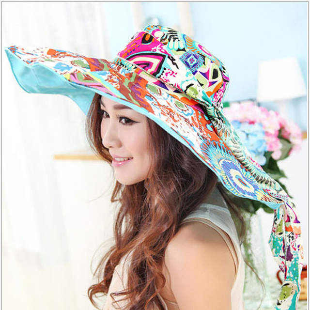 09df8bf9ad6 Women s holiday beach sun hats Caps 2018 Summer Fashion Prints Foldable  Floppy Sun Hats Ladies cute