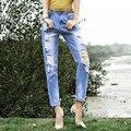 Novo 2016 moda feminina de jeans rasgado buraco denim azul Mid cintura cross calças friso alta qualidade calça jeans plus size feminino