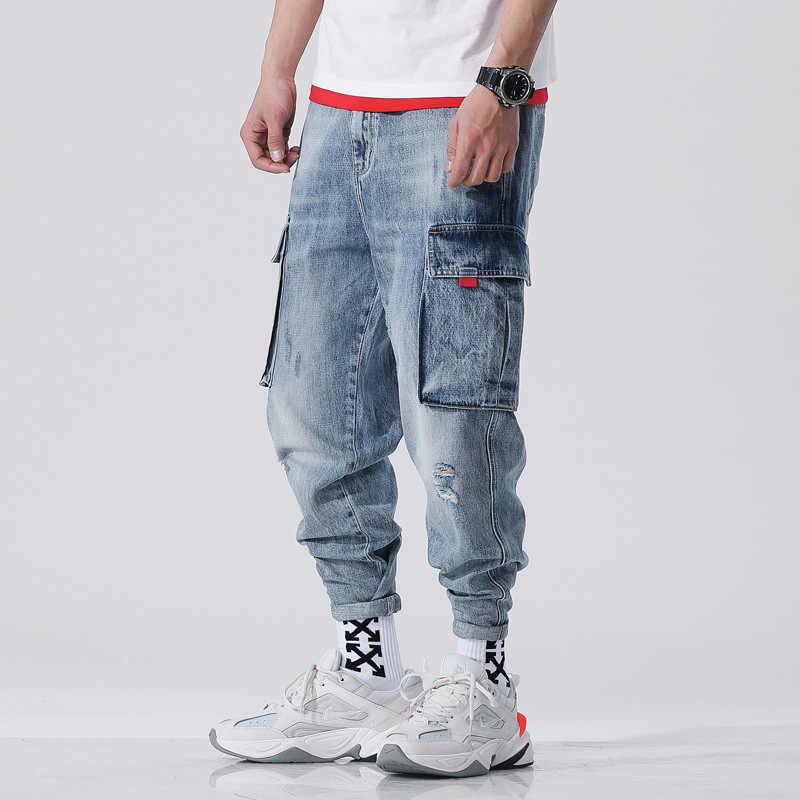 Japoński styl Vintage projektant męskie dżinsy jasnoniebieski biały mycia luźne duża kieszeń Denim spodnie Cargo Homme Hip Hop Harem dżinsy męskie