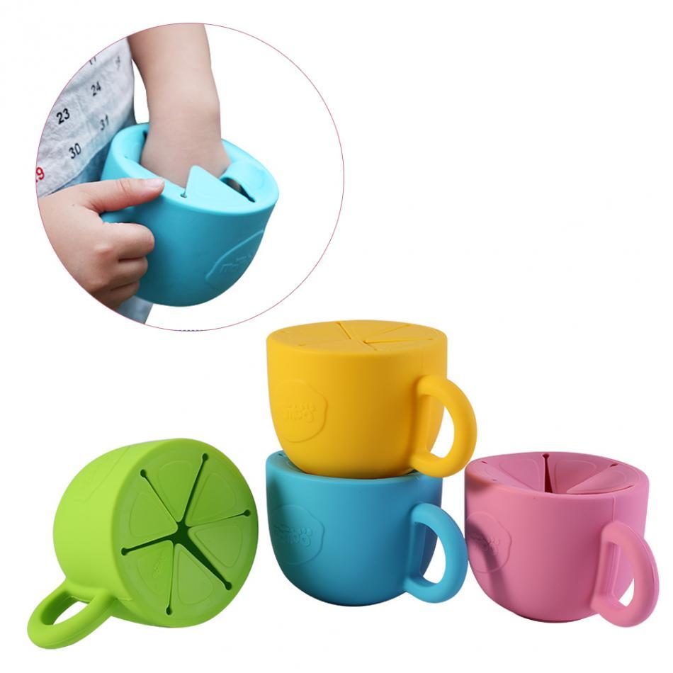Infantil Aperitivos Doble asa de la taza del beb/é del derramamiento Prueba Galletas recipiente de alimentaci/ón Galletas cuenco color al azar