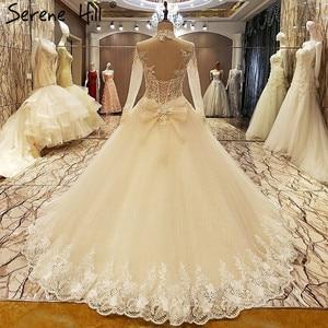 Image 2 - גבוהה צוואר סקסי תחרה חתונה שמלות 2020 שמפניה נצנצים אפליקציות חתונת הכלה Vestido דה Noiva נדל תמונה