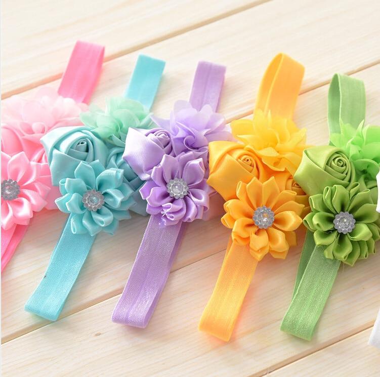venda de la muchacha de flores de tela con vendas elsticos del pelo de la muchacha
