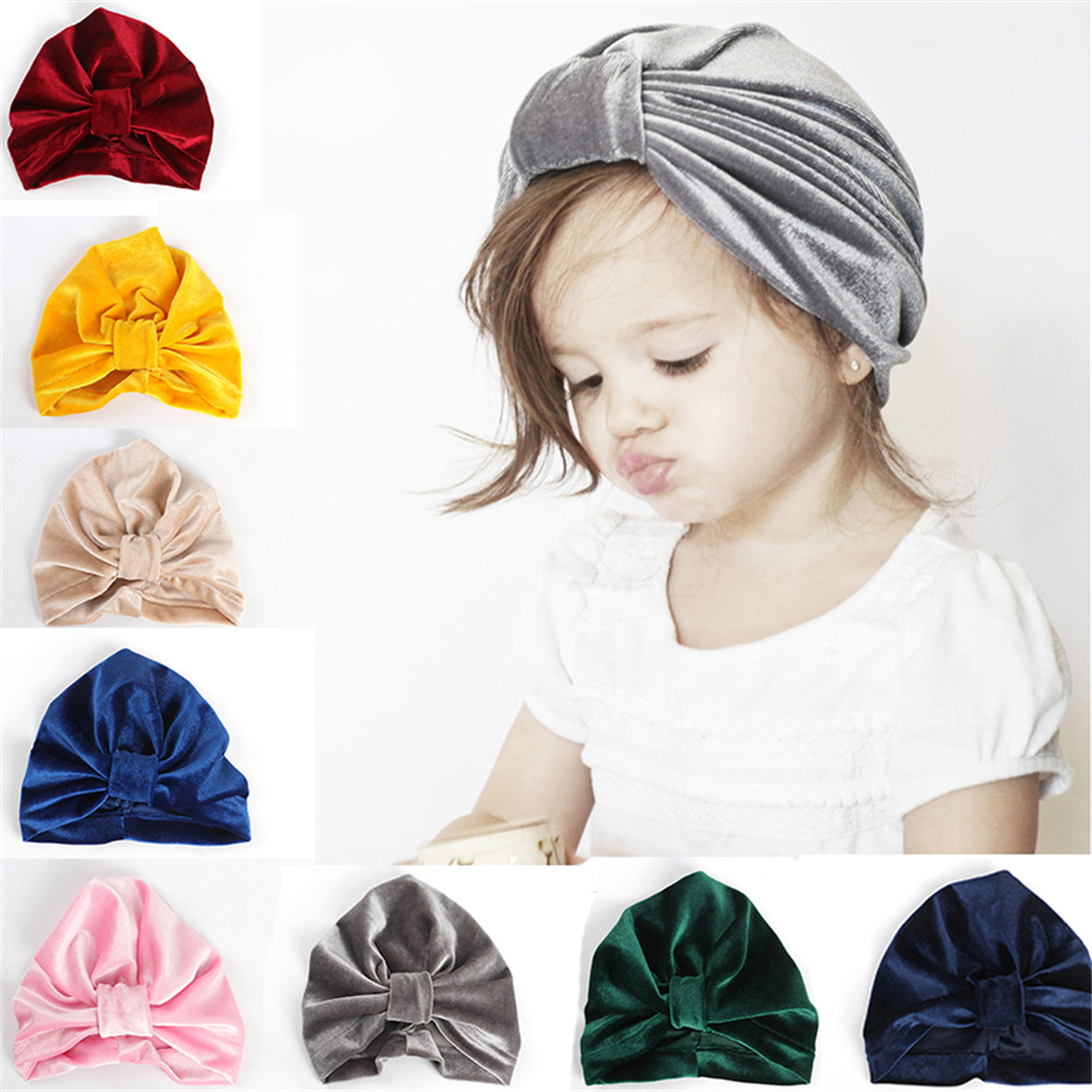 24cf46ef4e3 ... Solid Color Soft Cap Accessories. Baby Kids Gold Velvet Knotted Hat  Turban Infant Toddler Bowknot Beanie Warm Bebe Girl Boys Caps