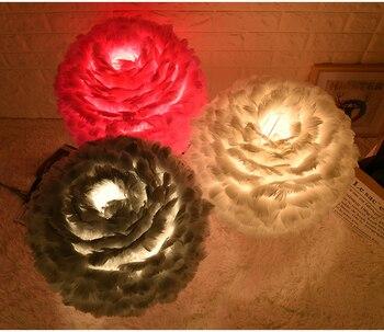Nowoczesne białe pióra lampa stołowa domu tabeli światła sypialnia lampki nocne hotelu butik kreatywny moda Art Home oświetlenie stołu E110