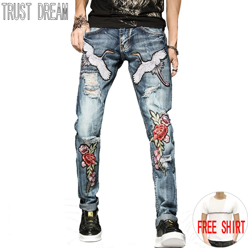 все цены на TRUST DREAM Europeans Designed Men Embroidered Flying crane Flower Ripped Hole Jean Casual Distressed Slim Man Fashion Jeans онлайн