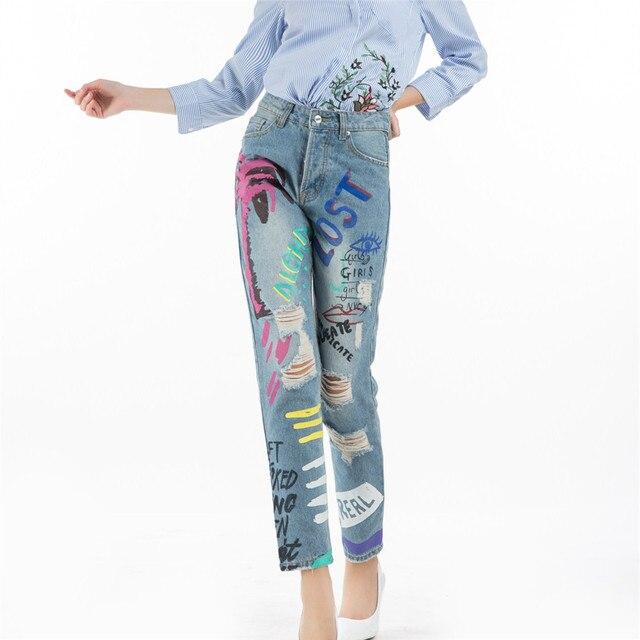 6a47cb2a15 2017 Retro pintado Graffiti agujero flecos rasgado mujeres azul Denim lápiz  pantalones de cintura alta Cool