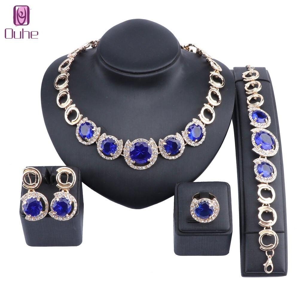 Купить комплект ювелирных изделий из кристаллов и фианита золотого