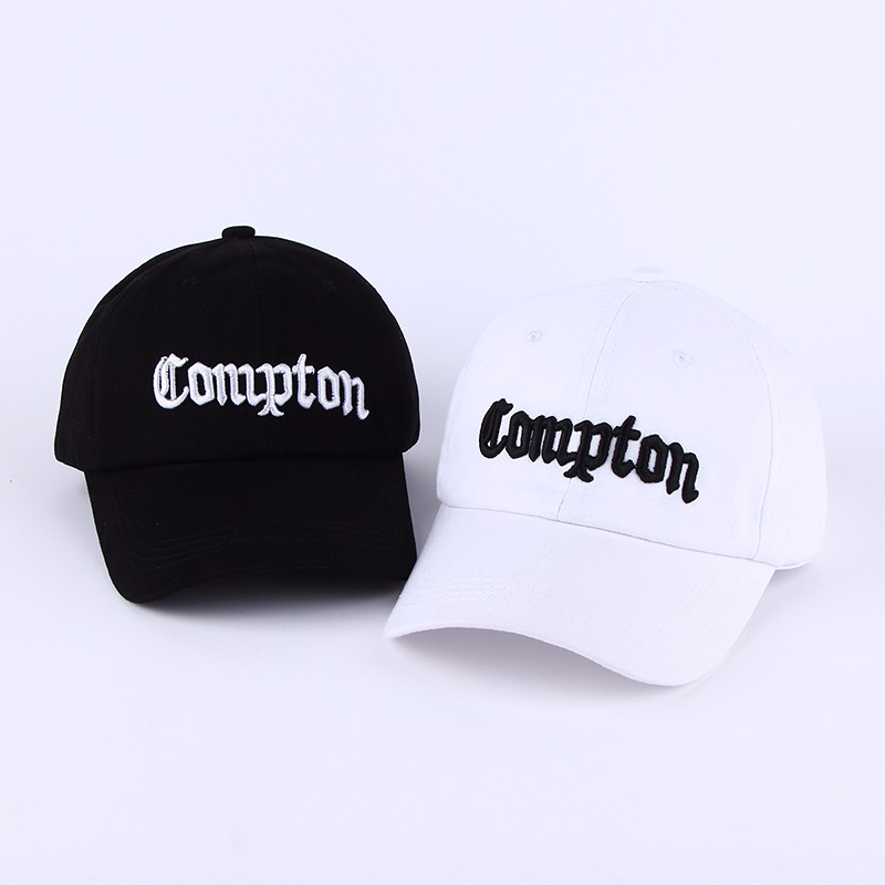 """Embroidered """"Compton"""" Adjustable Baseball Cap - Black Cap with White Lettering and White Cap with Black Lettering"""