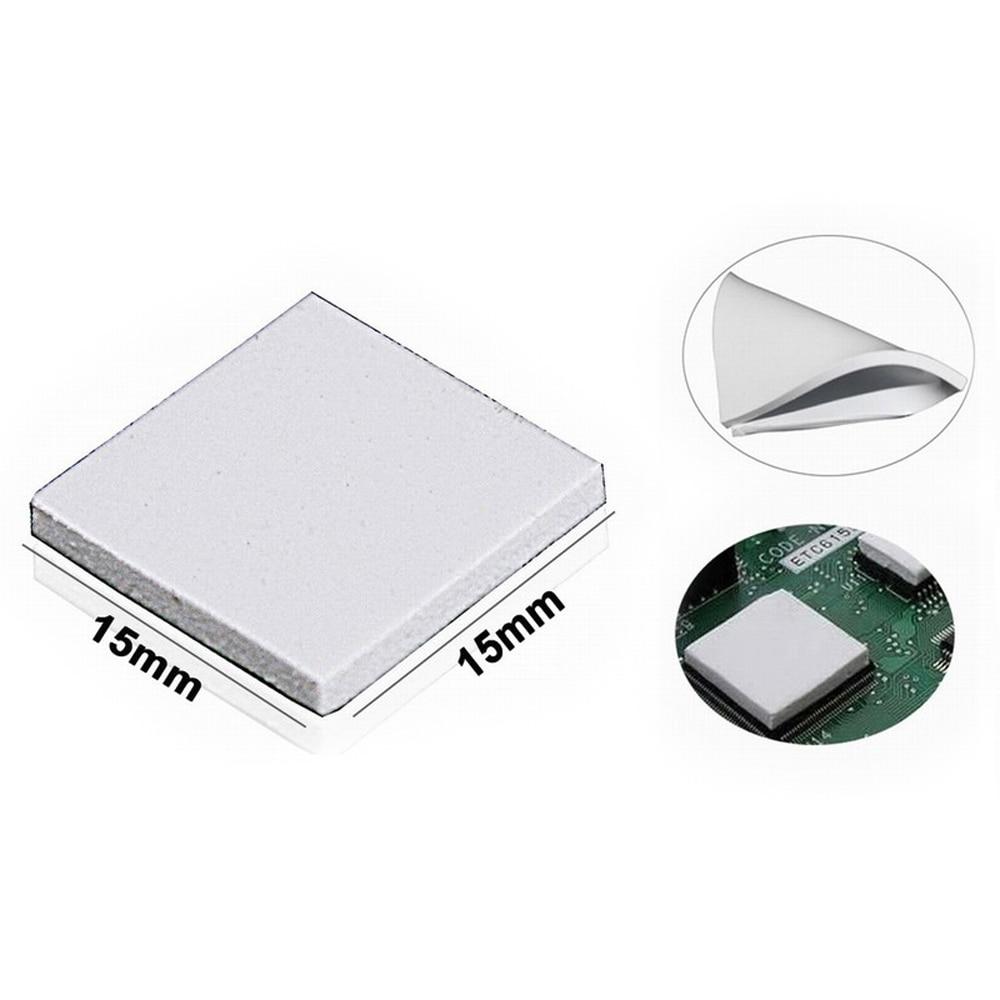 Купить с кэшбэком 100PCS Lot 15X15x2MM 2mm Thinkness White SMD DIP IC Chip Conduction Heatsink Thermal Paste Compounds Pad Pads