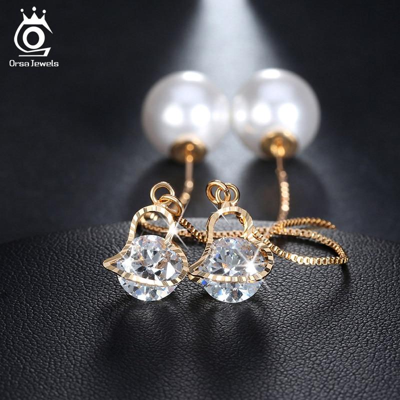 """""""ORSA JEWELS"""" širdies formos auskarai su ilgaausiais krištolo auskarais su dideliu imituotu perlu, elegantiški aukso spalvos papuošalai moterims OME26"""