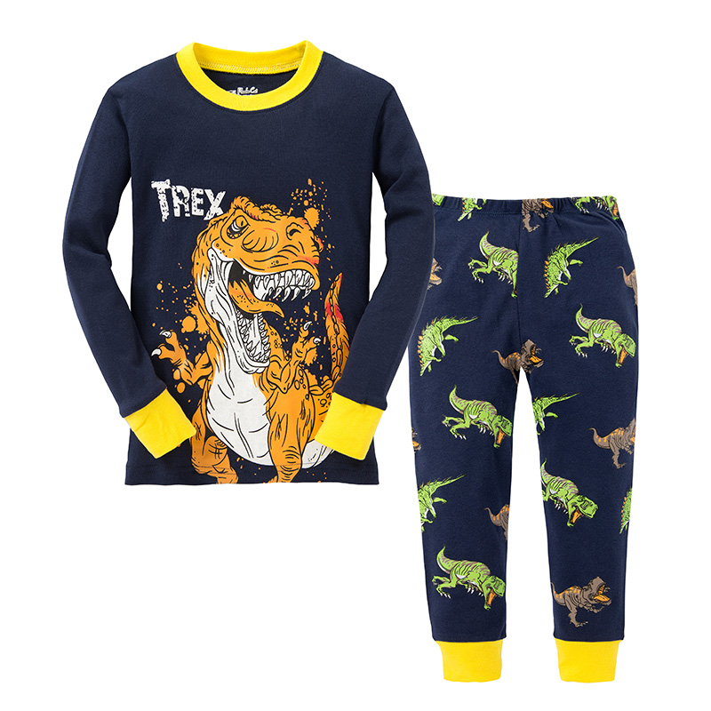 Boys () Carter's® 2 piece pajama set includes a long sleeve Snore T-Rex footprint screened top with a round neck and a pair of elastic waist fleece pajama pants with a straight leg and an all over dinosaur .