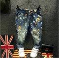 Venta caliente Niños Ropa de Primavera y Otoño nuevas niñas/niños vaqueros personalidad joker pequeños pantalones rectos Niños ocasional pantalones vaqueros