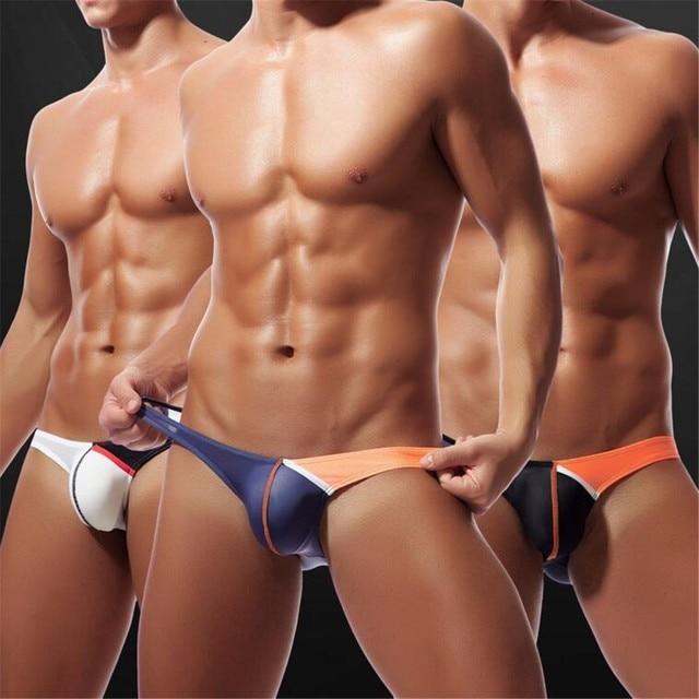 e9810e807d62 M-2XL Nylon Low Rise Mens Thongs and G Strings Sexy Men Underwear U Convex  Penis Pouch Panties Mens Briefs Jockstrap Plus Size