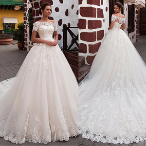 Image 1 - Attractive Tulle Off the shoulder Neckline Ball Gown Wedding Dress With Lace Appliques Short Sleeves Bridal Dresses