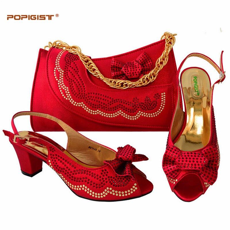 แต่งงานสีแดงจับคู่รองเท้าและกระเป๋าชุดรองเท้าส้นสูงผู้หญิงอิตาลีรองเท้าและชุดกระเป๋าตกแต่งด้วยRhinestoneอิตาลีรองเท้าและกระเป๋า-ใน รองเท้าส้นสูงสตรี จาก รองเท้า บน   1