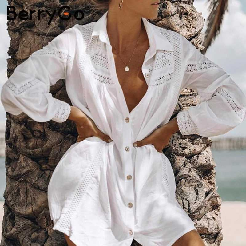 BerryGo Lange mouwen beach cover up blouse vrouwen Sexy white hollow out vrouwelijke katoenen blouse shirts Vakantie badpak cover- up tops
