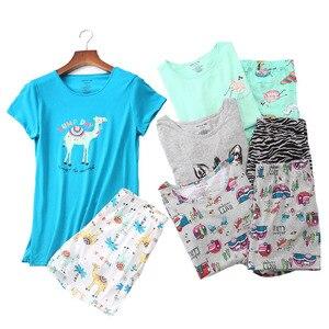 Image 1 - 2019 夏の女性のパジャマセット漫画の動物半袖 + ショーツ 2 個パジャマ韓国スタイルの快適ソフトラウンドネックホームウェア