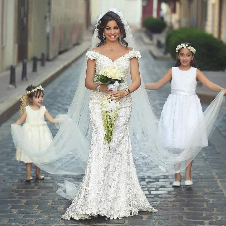 davids bridal wedding dresses bridal fashion week fall floral lace wedding dress David s Bridal Fall a line sheath dress with spaghetti straps and floral lace overlay