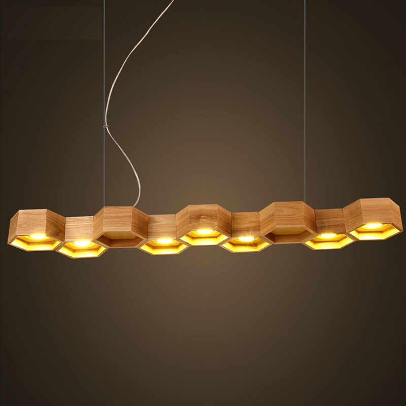 Slatted wooden honeycomb structure pilke series series for Suspension 4 lampes