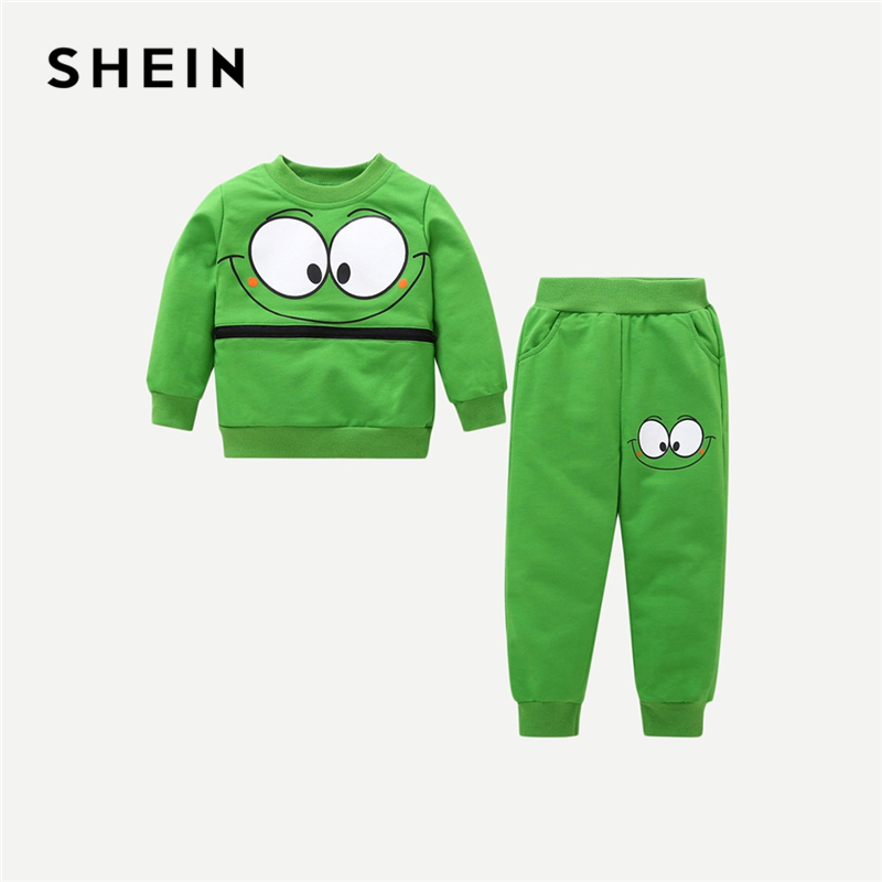 SHEIN Kiddie Toddler Boys Green Cartoon Print Sweatshirt And Sweatpants Teenagers Spring Long Sleeve Casual Suit Sets For Kids charming color block raglan sleeve asymmetric pullover sweatshirt for women