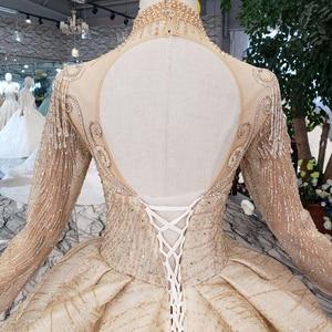 Image 5 - HTL245 Lange mouwen trouwjurken champagne hoge hals kralen bridal jurken baljurk keyhole terug jurk 2019 promotie