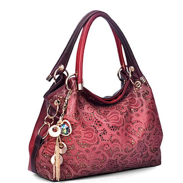 Ladsoul pu leather women handbag vintage hollow out women messenger bags flowers tassels bucket shoulder women bag HL4271