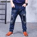 Pioneer crianças calças de brim venda solto patchwork novo 2016 meninos jeans rasgado buraco quebrado calças moda meninos crianças jeans de alta qualidade