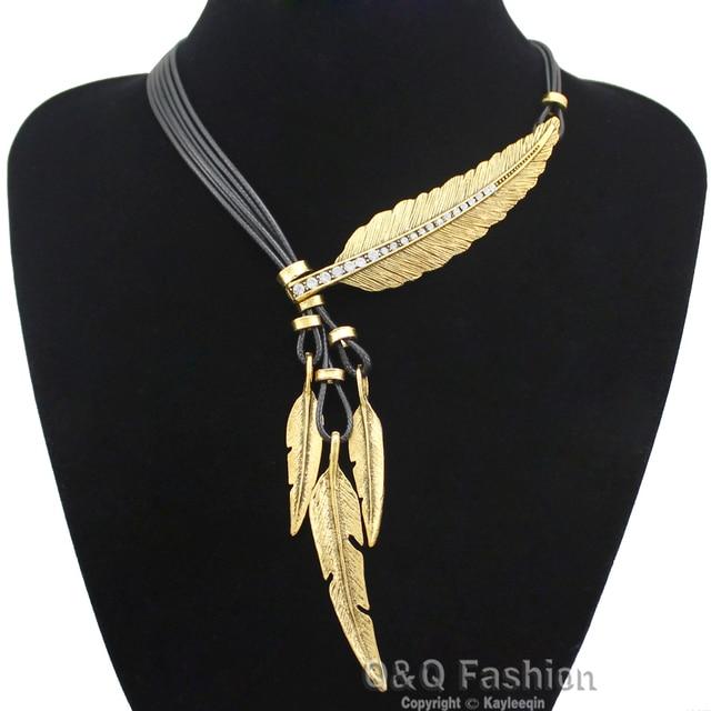 c00c5ed5acb6 Vintage oro y plata indio grande de la hoja pluma colgante encantos Lariat  cuero Zuni Navajo