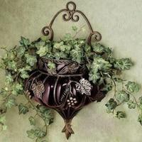 Wrought iron glass vase. Purple hanging decoration. Vase. Hydroponic flower arrangement. Hanging wall vase